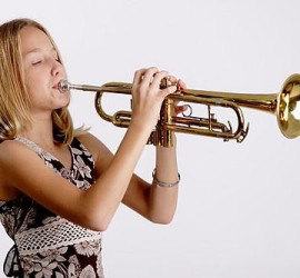 Stock Photograph of a young girl playing the trumpet